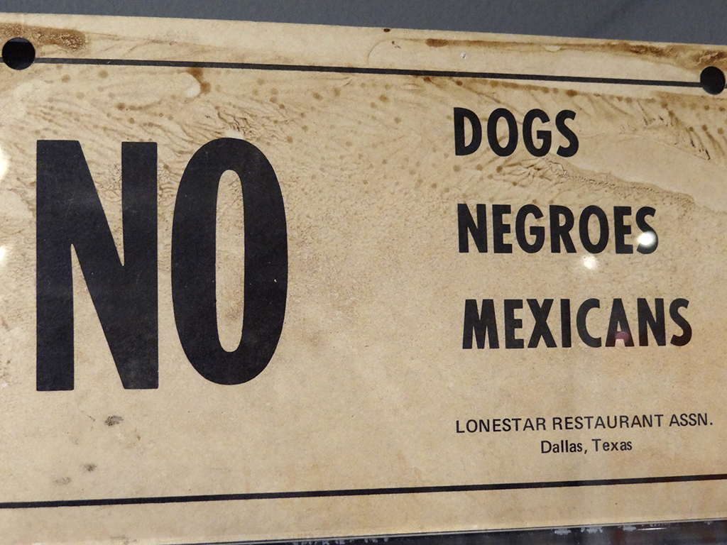 Sign stating no dogs, negroes, or mexicans