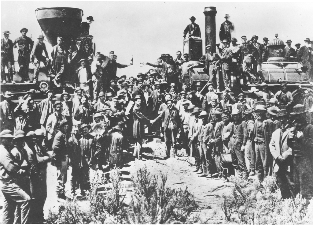 Railroad workers gathered in front of the driving of the golden spike