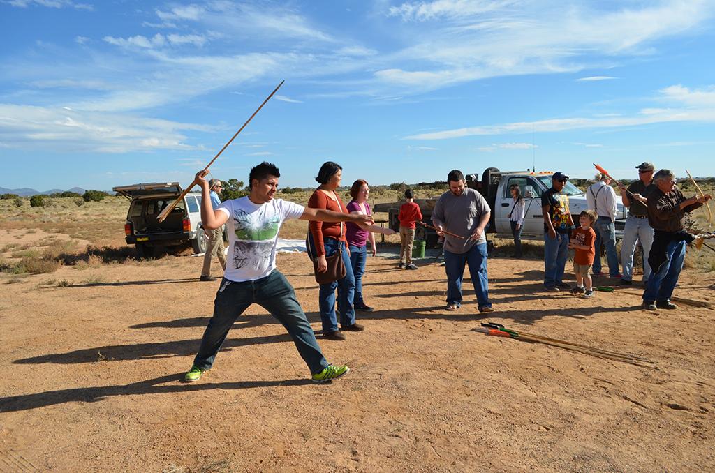 Archaeologist Jose-Pierre A. Estrada demonstrates throwing an atlatl