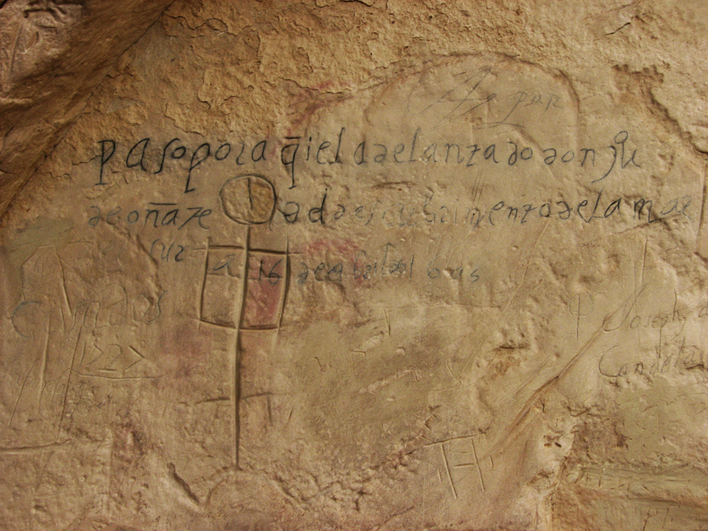"Juan de Oñate inscription on rock face at at El Morro which reads: ""Governor Don Juan de Oñate passed through here, from the discovery of the Sea of the South on the 16th of April, 1605."""