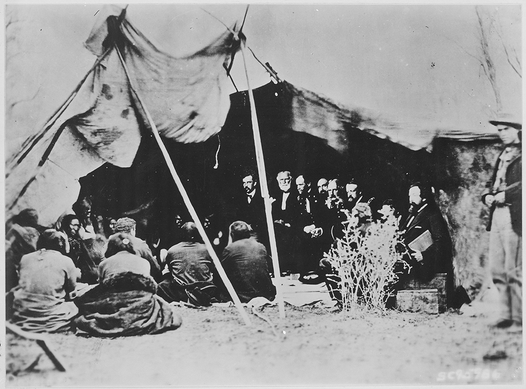 General William T. Sherman and commissioners in Council with Native American chiefs at Fort Laramie, Wyoming, c. 1868.
