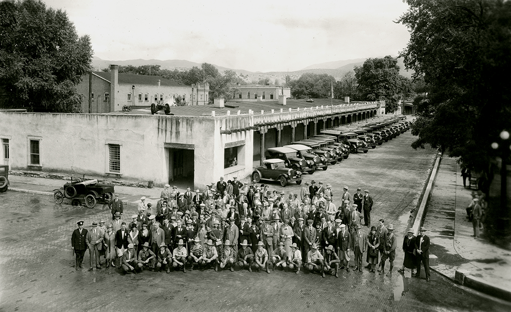Fred Harvey Company Indian Detour staff posed in front of the Palace of the Governors in Santa Fe