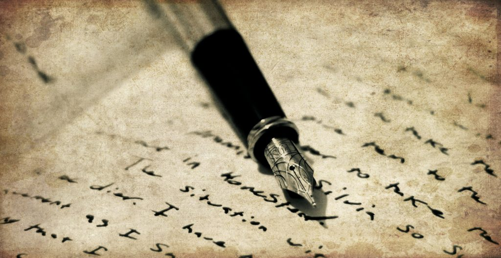 Quill on top of parchment