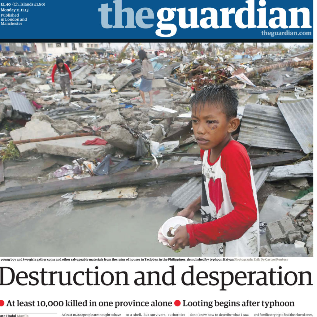 Child among wreckage on the cover of The Guardian