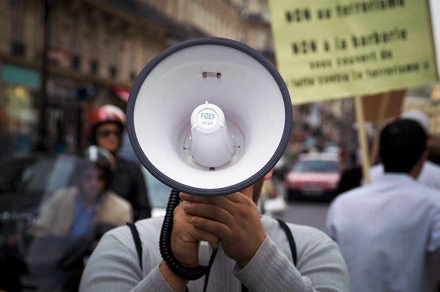 Man holding megaphone at protest