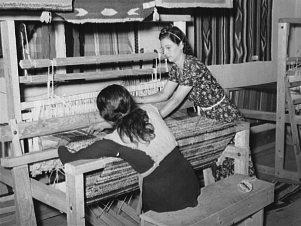 Native American woman weaves for WPA