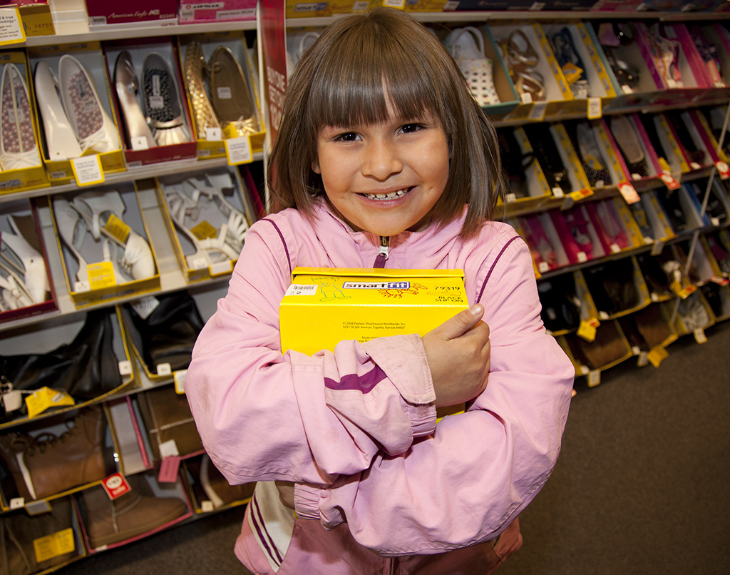 Recipient of a new pair of shoes during the LANL Laces Shoe Drive in 2012