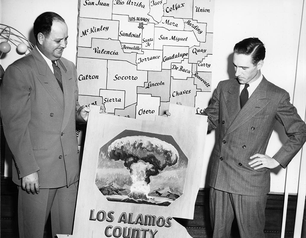 Two men revealing Los Alamos county