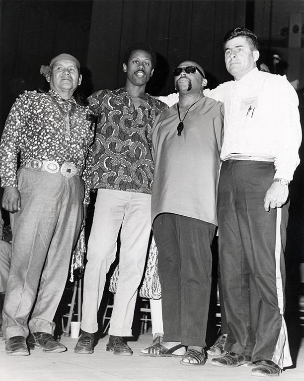 Hopi leader Thomas Banyacya, SNCC (Student Nonviolent Coordinating Committee) Representative Ralph Featherstone, Maulana Ron Karenga, and Reies Tijerina.