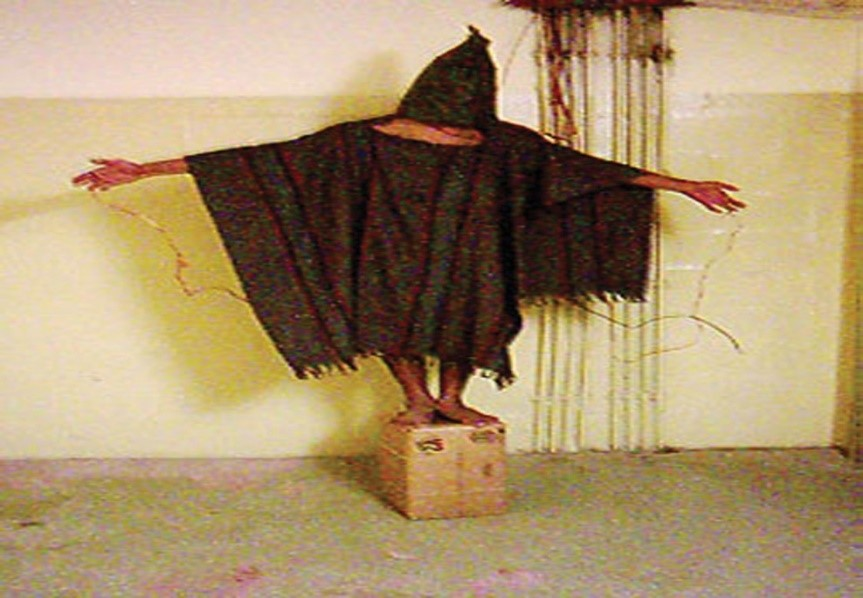 Iraqi prisoner being tortured by soldiers at the Abu Ghraib prison