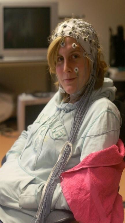 Woman wearing an EEG cap